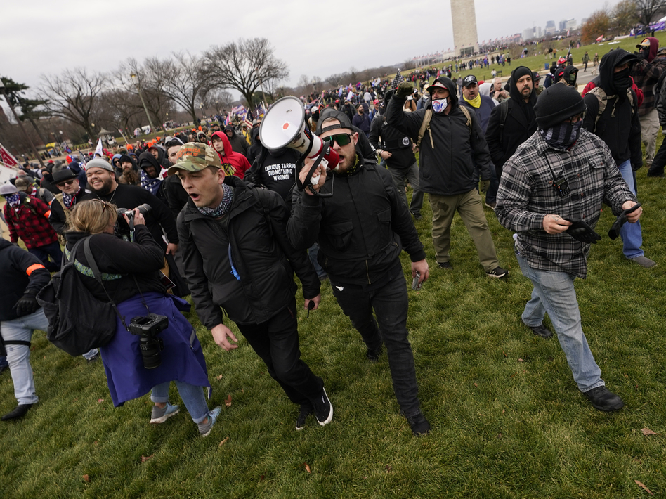 Ethan Nordean, with bullhorn, leads members of the far-right group Proud Boys before the riot at the U.S. Capitol on Jan. 6. The self-described sergeant-at-arms of the Seattle Proud Boys is facing federal charges over his role in the attack. (Carolyn Kaster/AP)