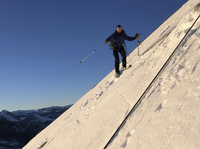 In this photo provided by Jason Torlano, Zach Milligan is shown on his descent down Half Dome in Yosemite National Park, Calif., on Feb. 21. The two men climbed some 4,000 feet to the top of Yosemite's Half Dome in subfreezing temperatures and skied down the famously steep monolith to the valley floor.