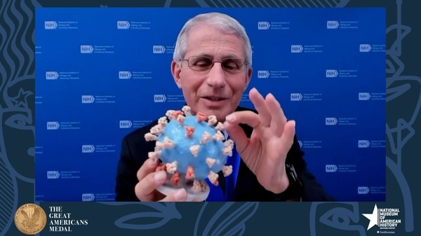 """Dr. Anthony Fauci holds his personal 3D-printed model of the SARS-CoV-2 virion during the """"Great Americans Awards Program."""""""