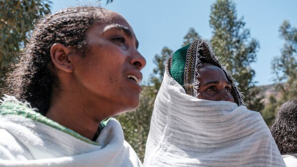 Women mourn the victims of a massacre allegedly perpetrated by Eritrean soldiers in the village of Dengelat, north of Mekele, the capital of Tigray.