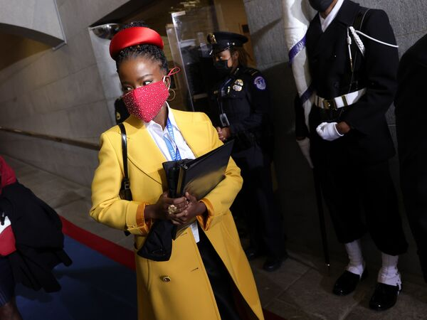 "Former National Youth Poet Laureate Amanda Gorman arrives at the inauguration of US President-elect Joe Biden on the West Front of the US Capitol on Jan. 20 in Washington, D.C. Gorman says she was tailed Friday night by a security guard who said she looked ""suspicious."""