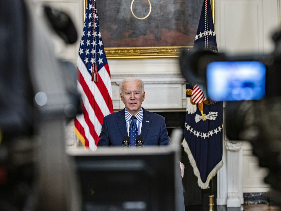 President Biden speaks from the State Dining Room of the White House on Saturday, following the Senate's passage of his COVID-19 relief package by a 50-49 vote. (Samuel Corum/Getty Images)