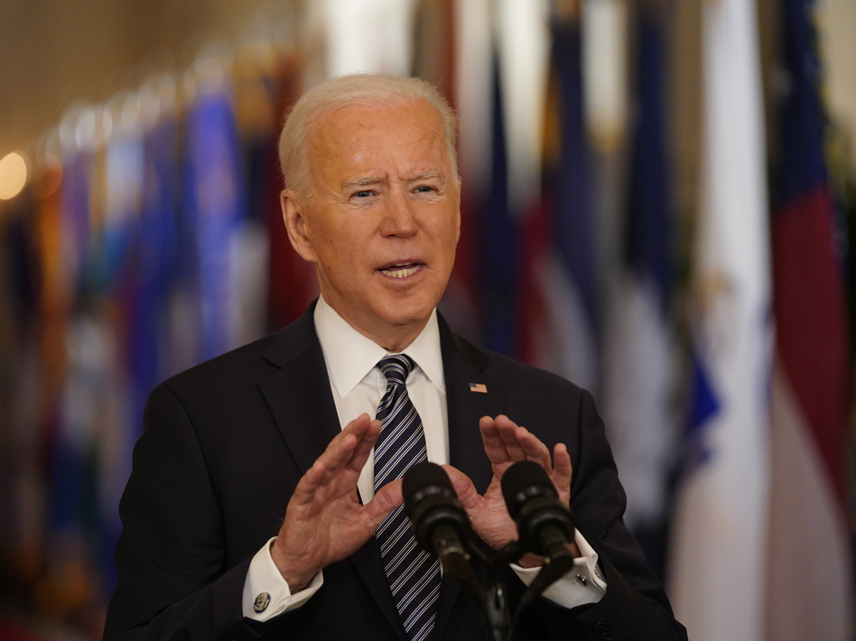"""President Biden did not call out his predecessor by name during his Thursday night address, but he did say that a year ago, the country was """"hit with a virus that was met with silence"""" and """"denial."""" (Chris Kleponis/CNP/Bloomberg via Getty Images)"""