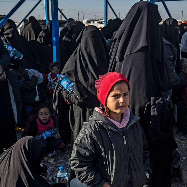 Syrians wait to leave the Kurdish-run al-Hol camp, which holds relatives of alleged Islamic State group fighters, in the Syrian northeastern al-Hasakeh governorate, in December.