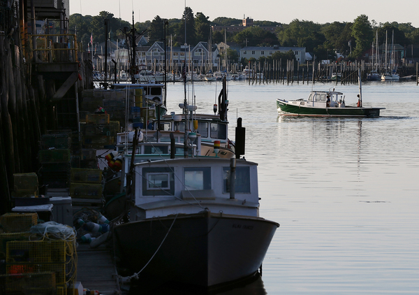 Fishing fleets, like lobster boats in New England, are beginning to find their catch is migrating in a warming climate.