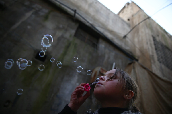 Jan. 19, 2017: Douma — A young girl blows bubbles.