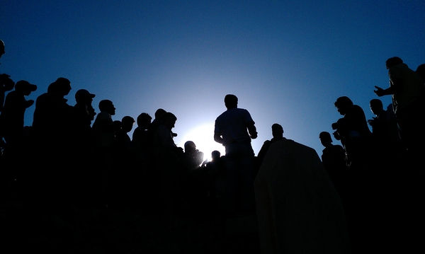 May 12, 2012: Barzah, Damascus — Mourners gather in a cemetery to pray for those killed in protests against the Syrian government.
