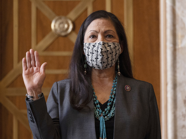 Rep. Deb Haaland, D-N.M., is sworn in before her Senate confirmation hearing to be Interior Secretary last month. Her confirmation makes her the country's first Native American cabinet secretary.