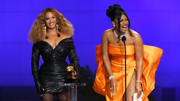 Beyoncé and Megan Thee Stallion accept the best rap performance award for