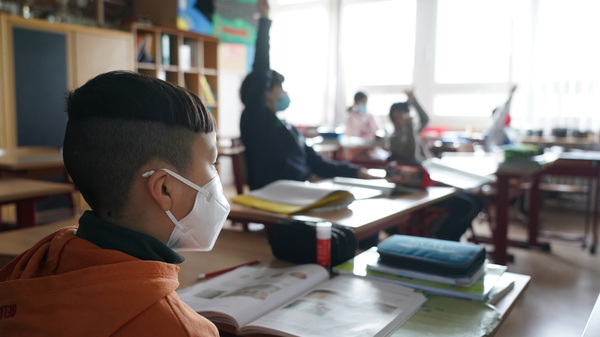 Moderna is testing its COVID-19 vaccine in young children; it's currently authorized for ages 18 and up. Here, third grade children attend school earlier this month in Berlin, as classes were allowed to meet in person at 50% capacity.