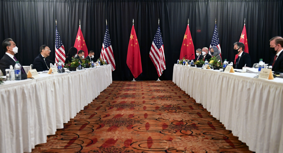 Secretary of State Antony Blinken (second from right), joined by national security adviser Jake Sullivan (right), speaks while facing Chinese Communist Party foreign affairs chief Yang Jiechi (second from left) and China's State Councilor Wang Yi (left) at the opening session of U.S.-China talks at the Captain Cook Hotel in Anchorage, Alaska on Thursday. (Frederic J. Brown/AP)