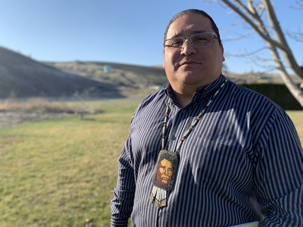 The Nez Perce tribe's vice chairman Casey Mitchell proudly wears a bead necklace sewn by his mother as a college graduation present that depicts Chief Joseph.