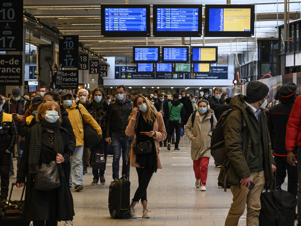 Travelers waited to flee Paris at the Montparnasse Train Station on Friday ahead of a new lockdown announced by the government in response to a surge in cases of the coronavirus.
