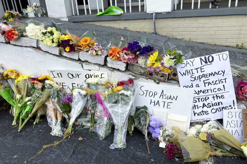 A makeshift memorial is seen on Friday in Atlanta, following the mass shooting of eight people, six of whom were of Asian descent, at three different massage parlors. (Candice Choi/AP)