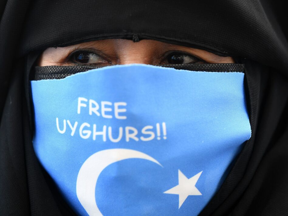 A protester near China's consulate in Istanbul on March 8. (Ozan Kose/AFP via Getty Images)