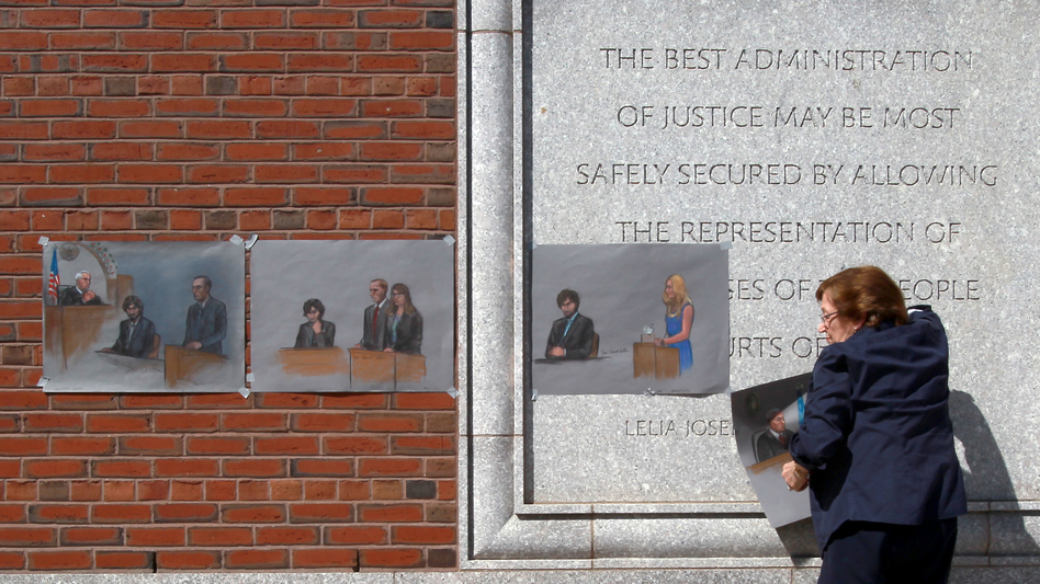 The U.S. Supreme Court will review a lower court's decision from last summer that vacated the six death sentences imposed on Boston Marathon bomber Dzhokhar Tsarnaev. Here, artist Jane Flavell Collins pulls down her courtroom sketches outside the Moakley U.S. Courthouse in Boston after Tsarnaev was sentenced. (John Blanding/Boston Globe via Getty Images)