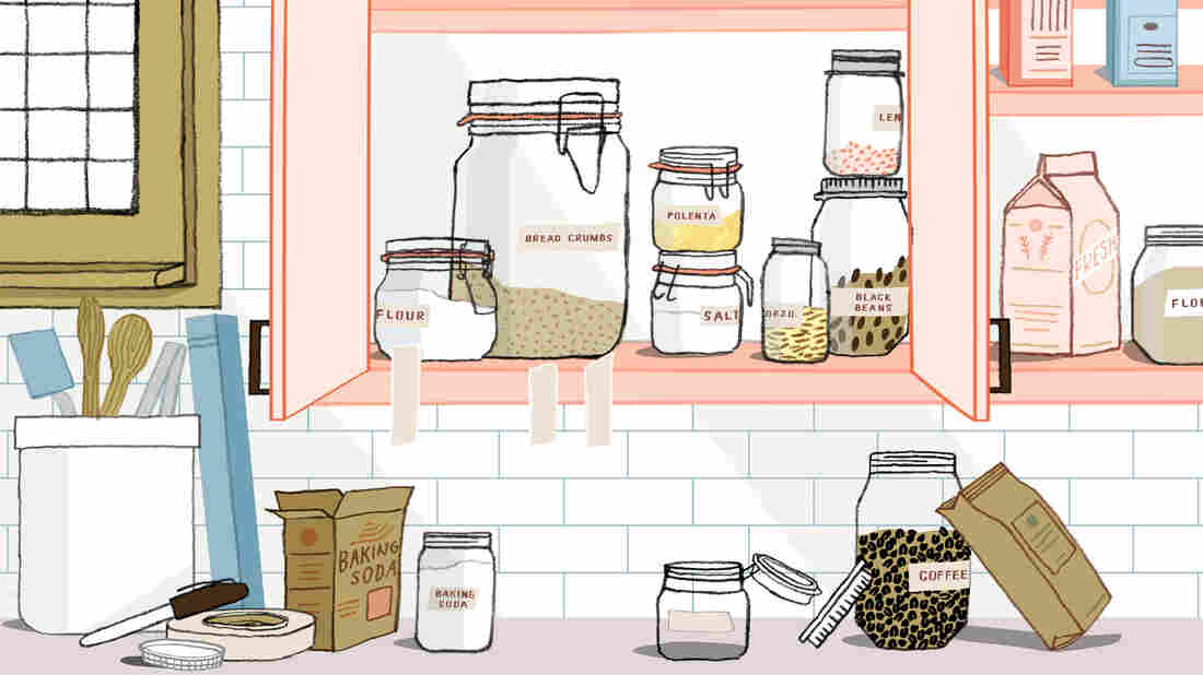 Illustration of section of kitchen counter and cabinet space in the process of being organized. The cabinets are filled with labeled glass jars containing dry goods. Torn pieces of of masking tape hang from the cabinet. The counter is scattered with ingredients and a roll of masking tape and a permanent marker used for making labels for glass jars of ingredients.