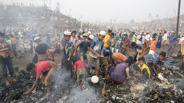 Rohingya refugees search for their belongings after a massive fire broke out at the Balukhali refugee camp, Cox's Bazar, Bangladesh, on Monday.