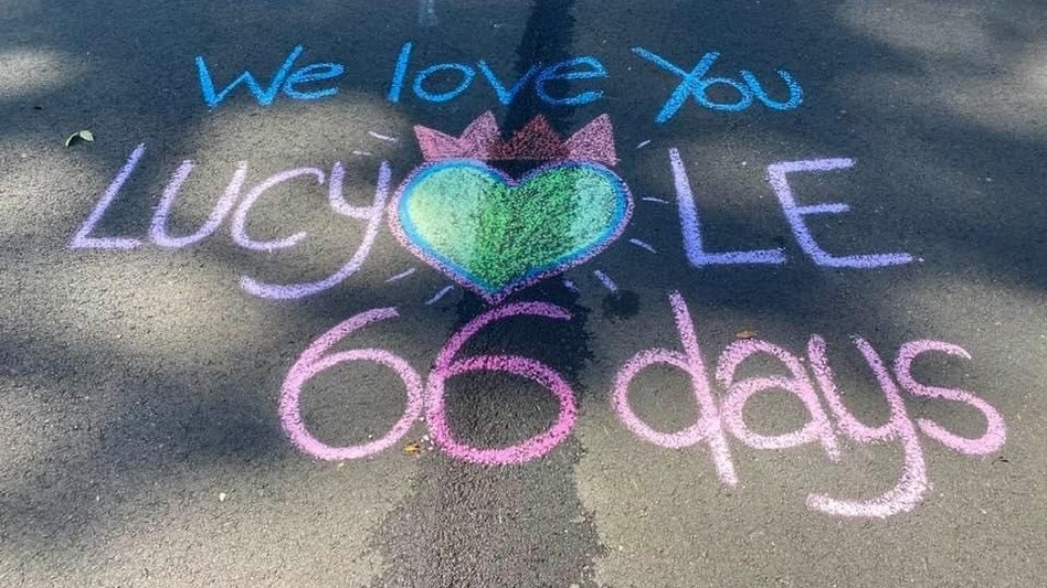 """Last summer, Lucy Le was killed on a street near her Virginia home by a neighbor backing out of her driveway. Her daughter, Laura Pho, now draws a new memorial to her mother every day on the pavement where she died. """"It's my meditation,"""" she says. """"It's my way of honoring her."""" (Courtesy of Laura Pho)"""