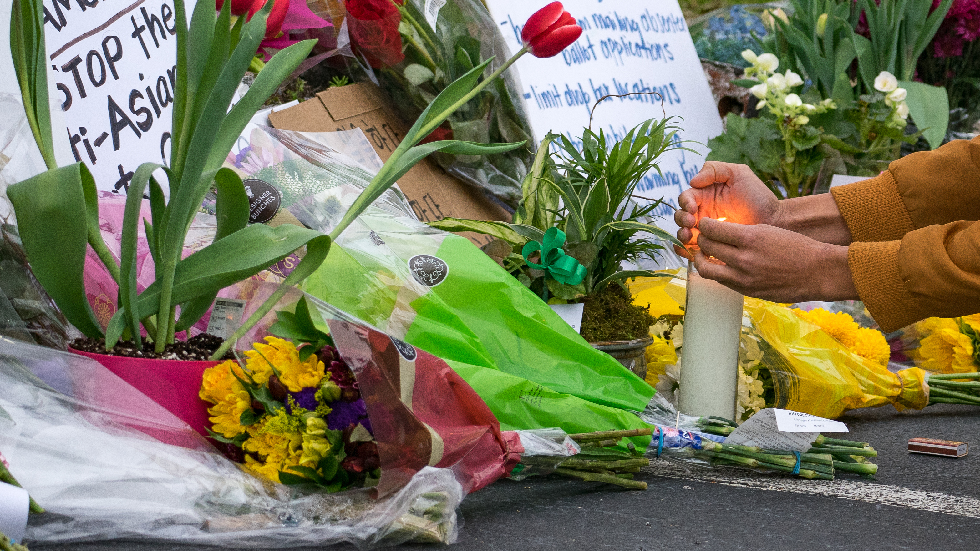 Mourners paid their respects at a makeshift memorial outside of Gold Spa on March 19 in Atlanta, Ga., after shootings at three area spas killed eight people, including six women of Asian descent.