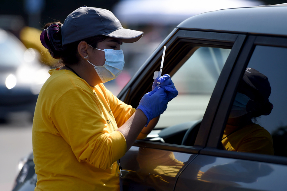 A worker prepares to give a COVID-19 vaccine last week at the Dignity Health Sports Park in Carson, Calif. ( Brittany Murray/MediaNews Group/Long Beach Press-Telegram via Getty Images)