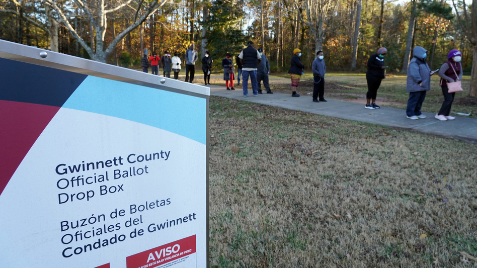 Voters stand in line to cast their ballots during the first day of early voting in the U.S. Senate runoffs at Lenora Park in Atlanta in December 2020. (Tami Chappell/AFP via Getty Images)