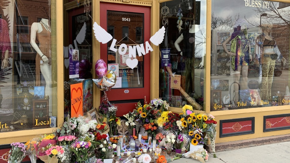 A makeshift memorial in front of a downtown Boulder store that shooting victims Tralona Bartkowiak co-owned with her sister. (Kirk Siegler /NPR)
