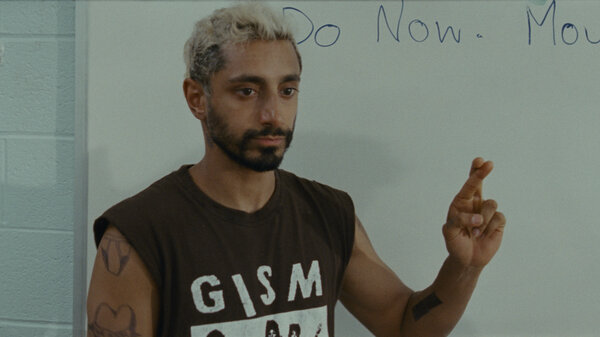 Ruben, played by Riz Ahmed, learns how to sign his name in Sound Of Metal.