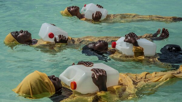 """Kijini Primary School students learn to float, swim and perform rescues on Oct. 25, 2016, in the Indian Ocean at Muyuni, Zanzibar. """"It was phenomenal to watch their facial expressions and body language shift from total fear and utter trepidation to peaceful, and then to what ultimately revealed itself as confidence and joy,"""" says photographer Anna Boyiazis, who won one of this year's awards."""