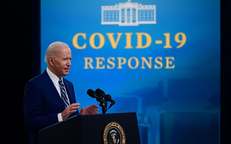 Two-thirds of American adults polled approve of the job that President Biden is doing with the coronavirus pandemic. That's nearly twice as high as those who say the same of Biden's job on immigration. (Jim Watson/AFP via Getty Images)