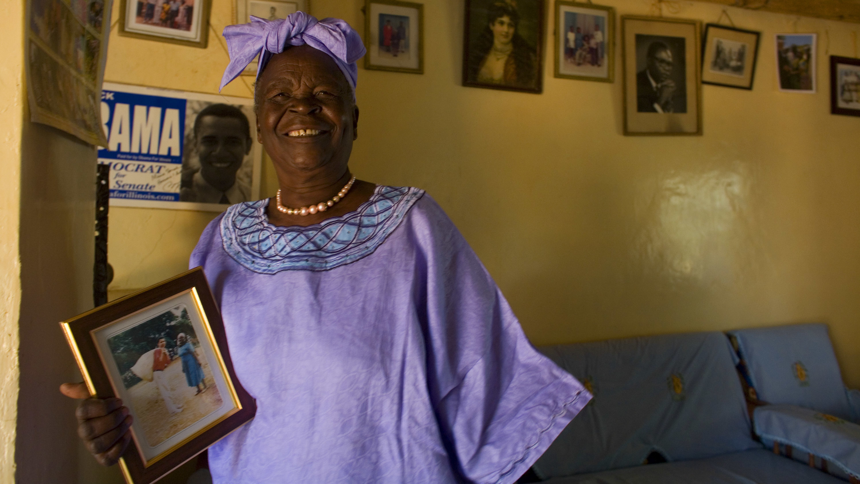Sarah Obama holds a photograph of her grandson, Barack Obama in Kogelo, Kenya while awaiting the results of Super Tuesday's primary in Feb. 2008. She died on Monday after a brief illness, and is being remembered as a beloved matriarch and philanthropist.