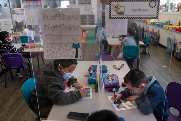 Pre-kindergarten students work on their school work at West Orange Elementary School in Orange, Calif. The Centers for Disease Control and Prevention relaxed its social distancing guidelines for schools on March 19, saying students can now sit 3 feet apart in classrooms.