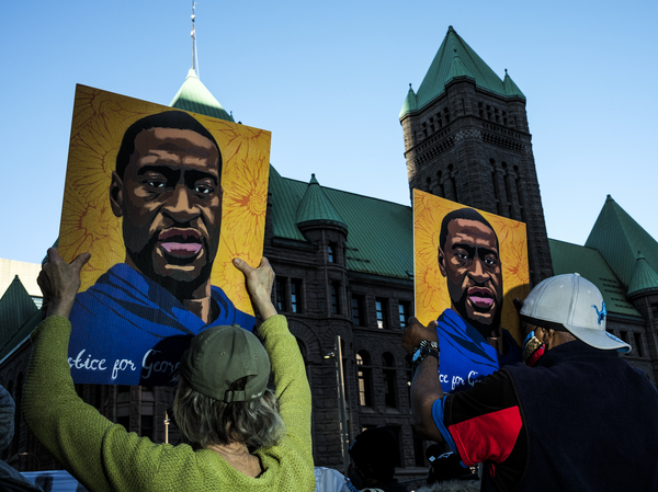 People gather during a demonstration outside the Hennepin County Government Center in Minneapolis on Monday as opening statements were given in the trial of former Minneapolis police officer Derek Chauvin, charged in the killing of George Floyd.