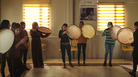 Rana Sulaiman Halo (center), performs with a traditional <em>daf</em> drum with the Ashti (Peace) Choir.