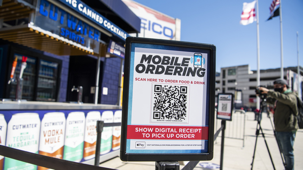 A mobile ordering sign is seen on March 30 at a vending station in Nationals Park, home of the Washington Nationals. The Nats, along with many other teams in baseball, are implementing new safety protocols, including for ordering food, as a new season kicks off on Thursday.