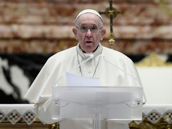 Pope Francis speaks prior to delivering his Urbi et Orbi blessing after celebrating Easter Mass on Sunday at St. Peter's Basilica in the Vatican.
