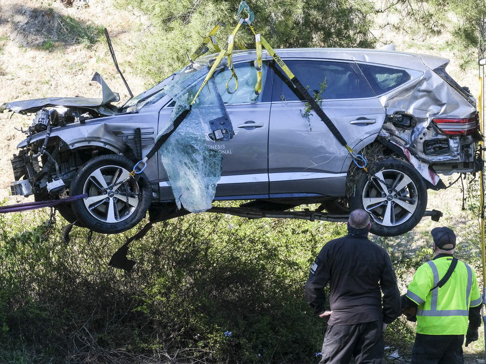 A crane is used to lift a vehicle driven by golfer Tiger Woods following a rollover accident in February in the Rancho Palos Verdes suburb of Los Angeles. (Ringo H.W. Chiu/AP)