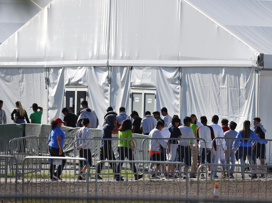 Children line up in February 2018 to enter a tent at the Homestead Temporary Shelter for Unaccompanied Children in Homestead, Fla. Many of these kids were taken from their parents after crossing the border illegally. (Wilfredo Lee/AP)