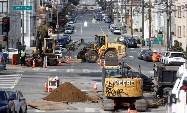 Workers operate a front-end loader as they make infrastructure repairs Wednesday in San Francisco.