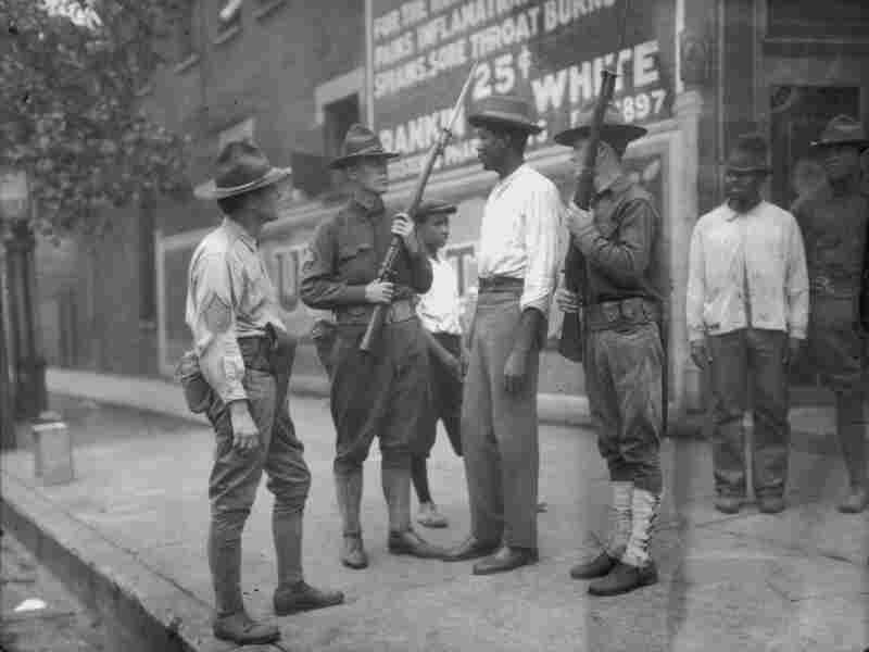 National Guardsmen questioning an African American man in Chicago, during the summer race riots of 1919.