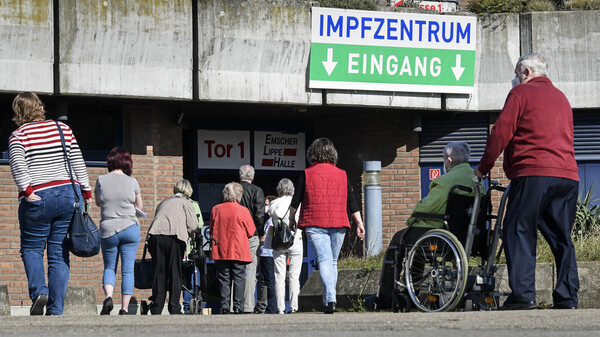 People wait in front of the vaccination center in Gelsenkirchen, Germany, Wednesday, last week. Germany