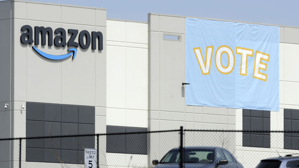 A banner encourages workers to vote in a union election at Amazon