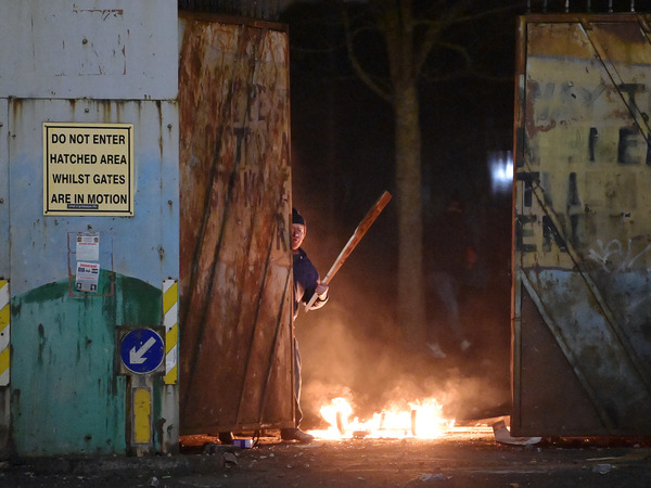 """Skirmishes erupted at the """"peace wall"""" dividing Protestant and Catholic neighborhoods on Wednesday night in Belfast, Northern Ireland."""