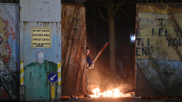 "Skirmishes erupted at the ""peace wall"" dividing Protestant and Catholic neighborhoods on Wednesday night in Belfast, Northern Ireland."