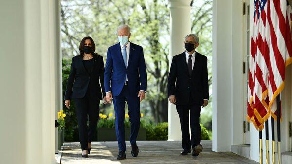 President Joe Biden, Vice President Harris and Attorney General Merrick Garland arrive at the White House Rose Garden to speak about gun violence prevention on Thursday.