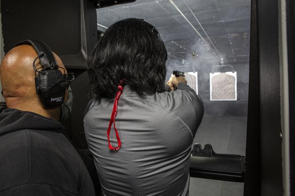 Edmon Muradyan, left, instructs Allen Soong, 47, at the shooting range on Saturday.