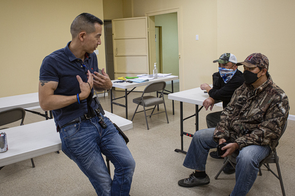 Left to right: Compton School Police Chief William Wu, 49, speaks with Anthony Refuerzo, 61, and Sunha Kim after the firearms training course.