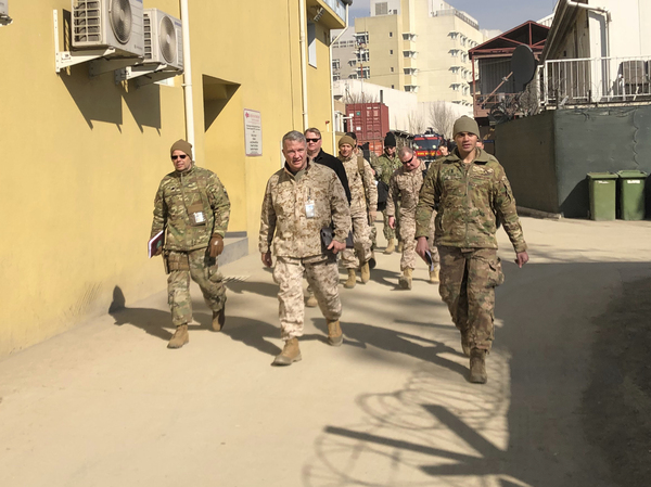 Marine Gen. Frank McKenzie, (center) is shown visiting Kabul, Afghanistan in January 2020. The Biden administration said it plans to complete a draw down of U.S. troops in the country by Sept. 11.