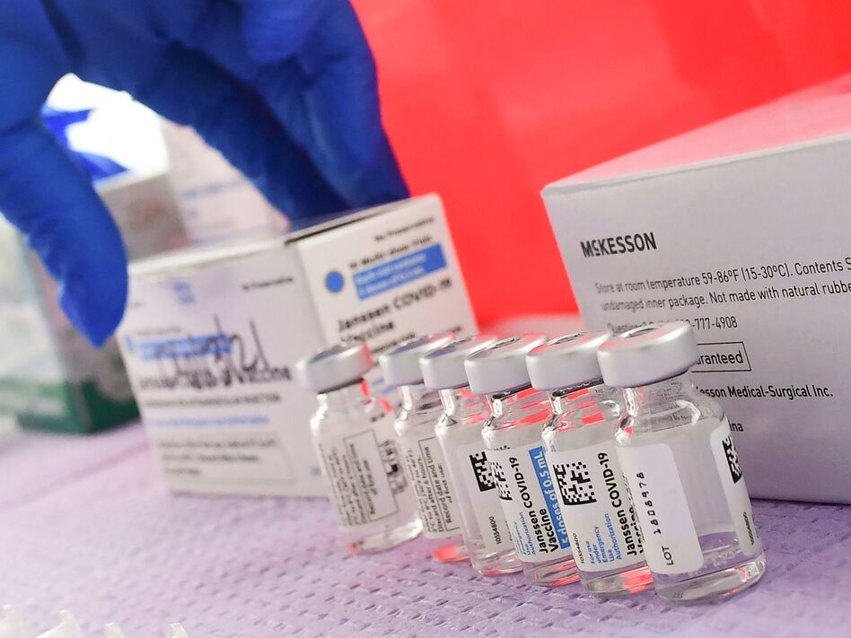 Bottles of the single-dose Johnson & Johnson Janssen COVID-19 vaccine await transfer into syringes for administering in March in Los Angeles. The CDC had called on Tuesday for a pause in administering the vaccine. (Frederic J. Brown/AFP via Getty Images)