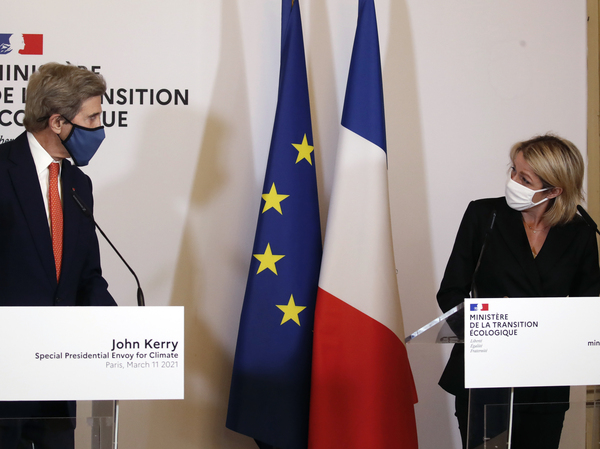 French Environment Minister Barbara Pompili and U.S. special envoy for climate John Kerry met in March. Kerry has been traveling around the world working to reestablish the U.S. as a trustworthy player in international climate diplomacy ahead of a summit in Washington, D.C., this week.